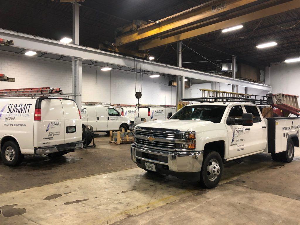 Summit Refrigeration Group service trucks parked in shop